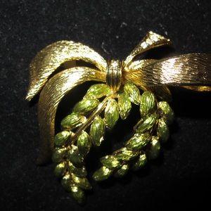 Joan Rivers green & gold brooch